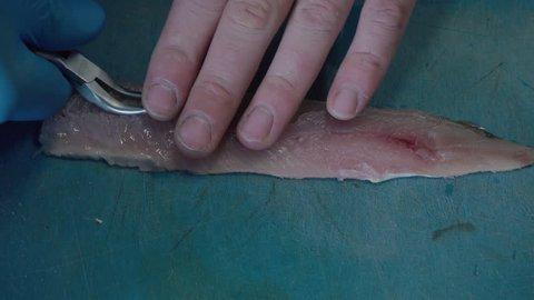 Taking off fish bones from fresh fish