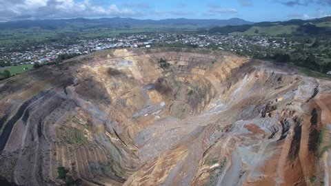 WAIHI, NEW ZEALAND - MAR 21: Aerial view over Martha open pit gold mine on March 21, 2018 in Waihi, New Zealand