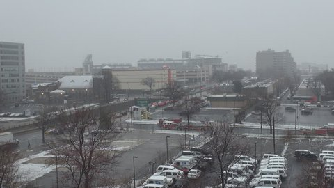 WASHINGTON DC - USA, MARCH 25, 2013, Aerial view of traffic car on busy highway, snow fall in winter day