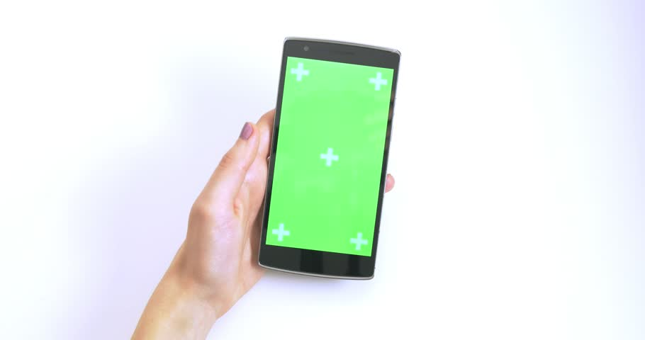 Woman Hand Scrolling On Green Screen Smart Phone With Trackers On White Background | Shutterstock HD Video #1009236644