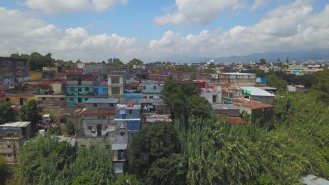Drone aerial Guatemala Antigua city Central America garbage dump shed, shack poverty village people.