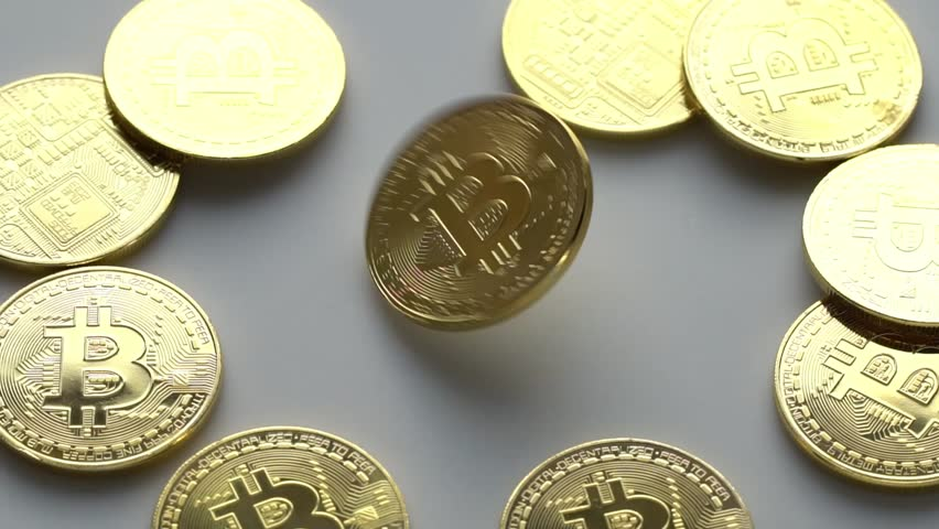 Coin golden bitcoin rotation, twist and falls on a white background. Slow motion video 120 fps. | Shutterstock HD Video #1009266644