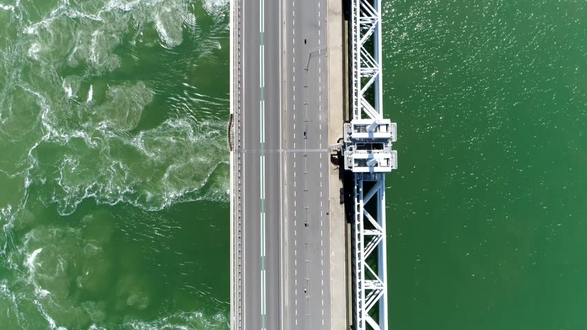 Aerial top down view of Eastern Scheldt storm surge barrier in Dutch Oosterscheldekering the largest of 13 ambitious Delta Works series of dams and storm surge barriers designed to protect Netherlands | Shutterstock HD Video #1009276514
