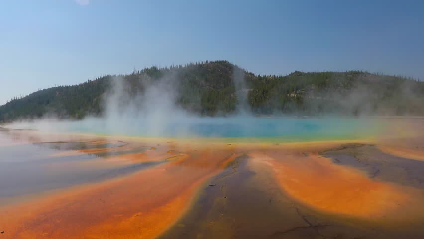 Yellowstone National park, USA, September 2018: time lapse of a walk around the colorful steaming grand prismatic spring geyser