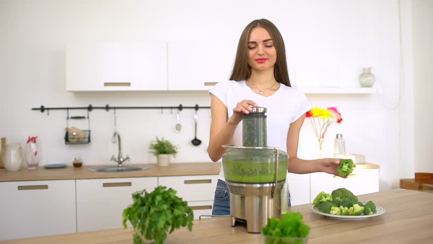 Hands close up female preparing workout session making fresh organic vegetable juice as part modern healthy lifestyle diet - Female Hands Blender Fresh Fruit Juice After Workout. slow-motion. Woman