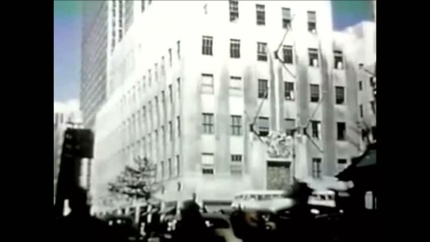 CIRCA 1952 - Visitors tour Rockefeller Center.