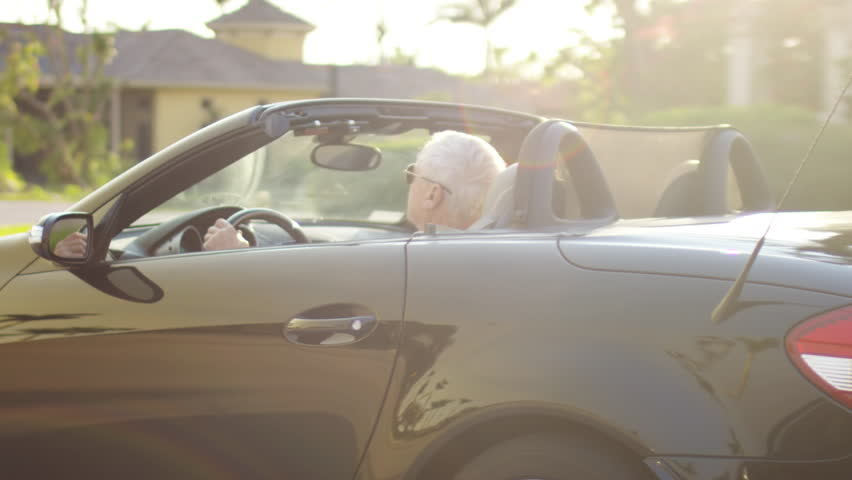 Carefree Senior Man Drives Through Affluent Neighborhood In His Luxury Convertible, In Sunny Florida - Shot On Red Scarlet-W Dragon In 4K/ Slow Motion