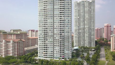 Ascending Aerial Shot of High Rise Condominums among Pubic Housing Estates in Singapore