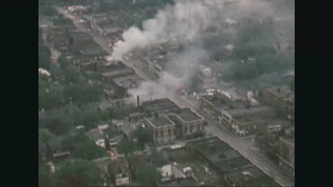 CIRCA 1967 - Aerial views of a burning block of buildings and destroyed homes during the Detroit Riots.