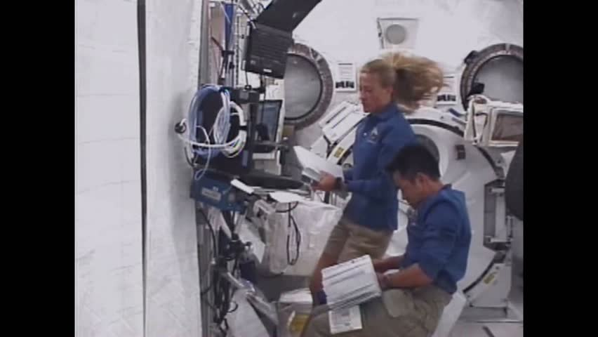 CIRCA 2008 - The crew of STS-124 Discovery work on the space arm of the Japanese Lab, and play around in zero gravity.