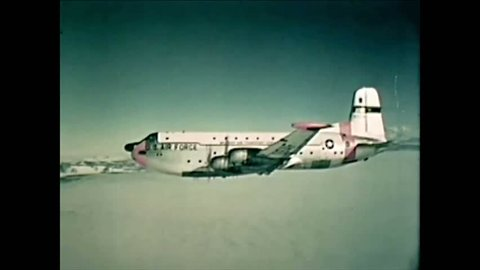 CIRCA 1961 - Captain Scott's 1919 Antarctic expedition site is shown as a USAF plane flies past.