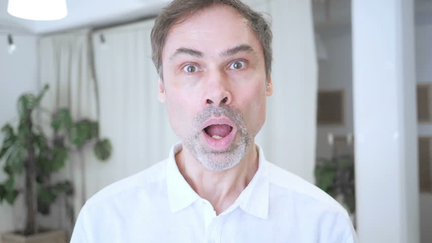 Slow Motion Portrait of Middle Aged Man in Shock, Wondering