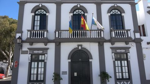 Traditional white building house with Spanish flags outside in Haria Lanzarote Spain