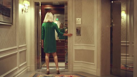 Opening empty elevator in hallway luxury hotel. Young woman running to elevator car but can not get in time. Woman entering in lift