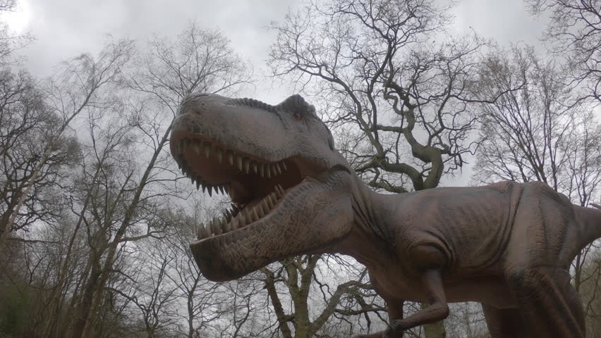Broxbourne, Hertfordshire, UK. April 4th 2018: Life size animated dinosaurs on display at Paradise Wildlife Park during the Easter half term holidays in the UK.