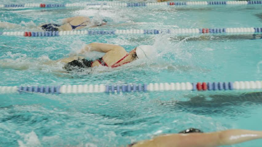 Girls racing in swimming pool lanes / Provo, Utah, United States