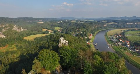 Aerial view a magnificent panoramic view of Bastai in Germany next to the river on a sunny day. On the background beautiful scenic nature.
