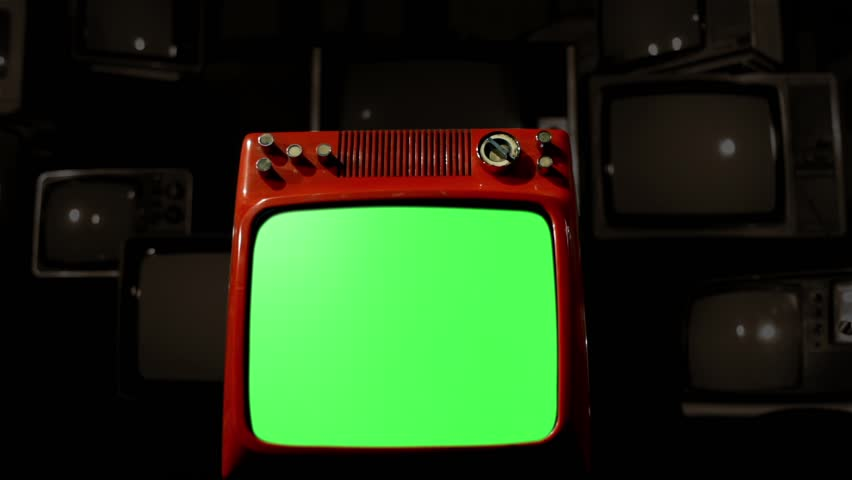 "Antique TV with Green Screen over a Black Bakground of Old TVs. Sepia Tone. Dolly Shot. You can replace green screen with the footage or picture you want. You can do it with ""Keying"" FX. 