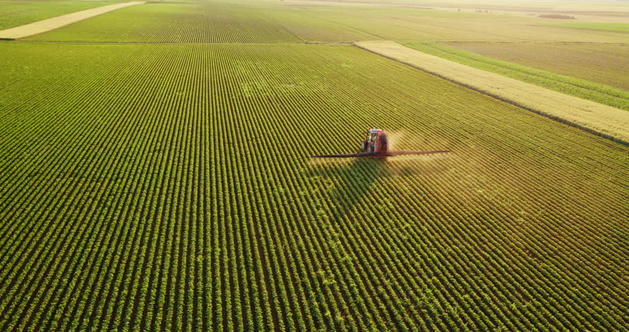 Aerial drone shot of a farmer spraying soybean fields | Shutterstock HD Video #1009501754