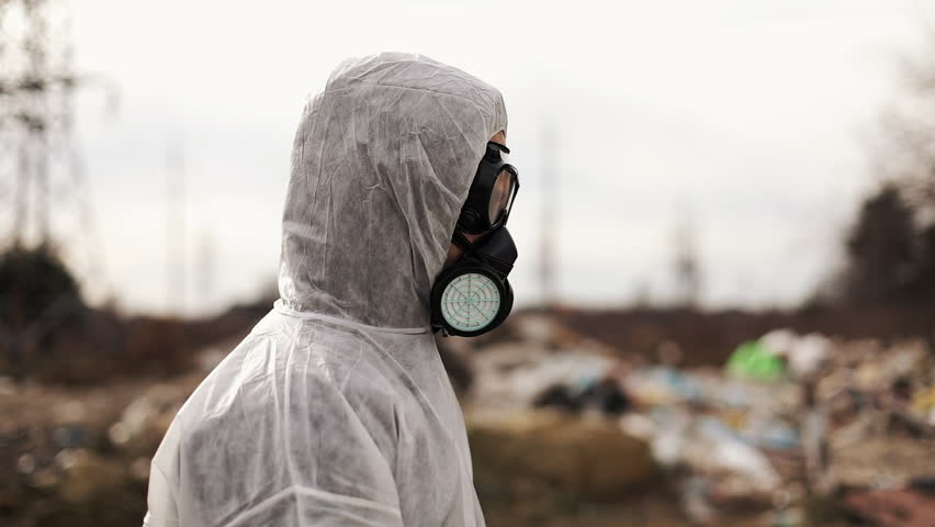 Virologist Man in Protective Costume and Respirator Gas Mask Walking near Landfill Site Pollution, Ecological Disaster | Shutterstock HD Video #1009509674