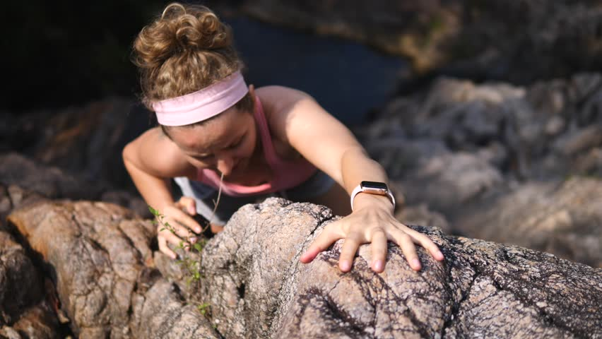 Sports Woman With Smartwatch Climbing The Rock Having Workout In Mountains #1009512854