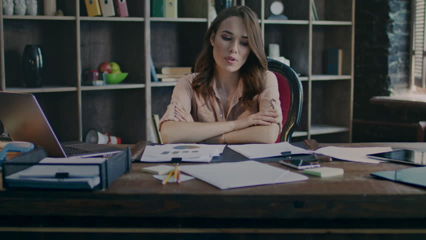 Annoyed woman tired at work. Upset marketer thinking about business down statistic. Sad businesswoman with bad mood taking phone in hand. Worried business employee working in office | Shutterstock HD Video #1009520924