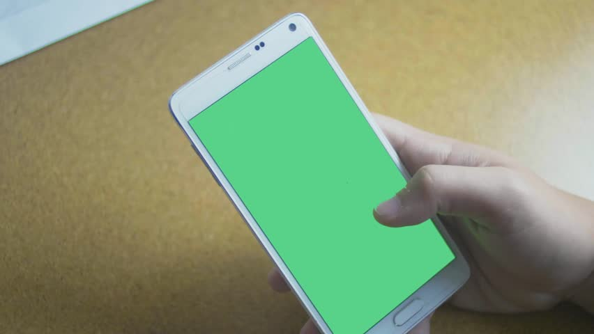 Green screen samsung galaxy smartphone touch screen (black / white) Chroma key VFX Footage at work desk office