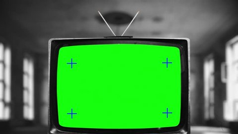 Retro antenna tv television green screen  zooming into the green screen of  an old television vintage style  black and white