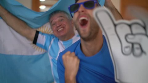 Argentina Father and Son Fans Watching and Celebrating a Soccer Game