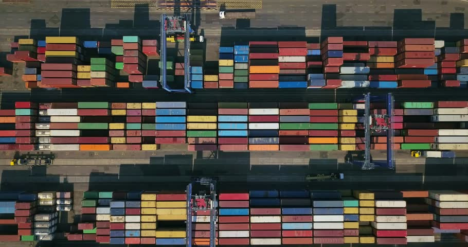 Odessa, Ukraine - 24 July 2017: Big warehouse with many multicolored containers. There are cranes and trucks. Aerial video recording. Editorial. | Shutterstock HD Video #1009566824