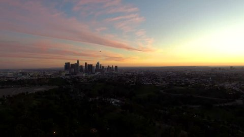 Aerial drone rise above Los Angeles at dusk