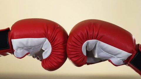Two opponents hands in boxing gloves, sport competition, resistance, conflict