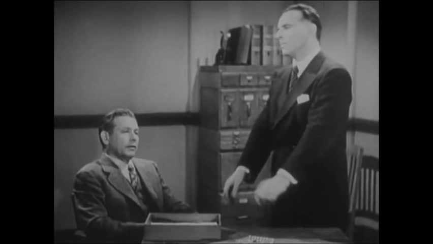 CIRCA 1940s - Undercover agent Al goes over his cover story with his supervisor.
