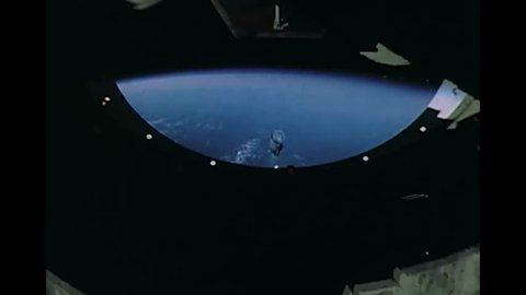 CIRCA 1969 - An on-board camera captures the view of the engine skirt and launch escape tower being separated from Apollo 11 in flight.
