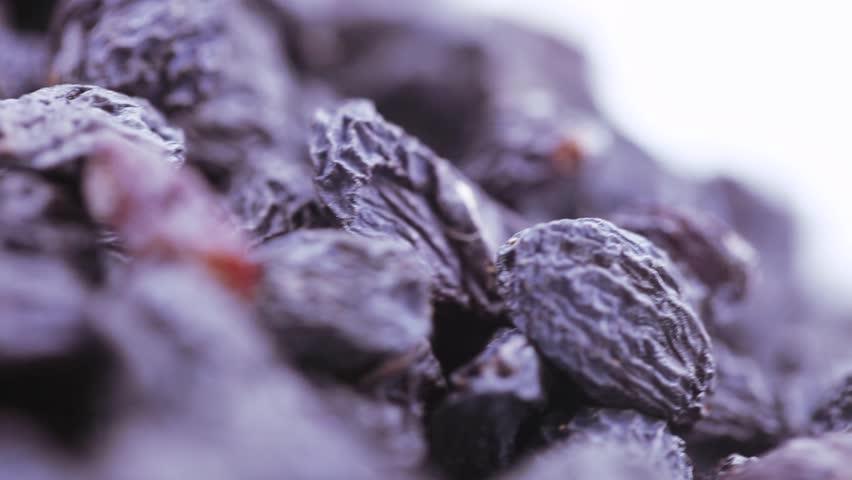 A pile of dried blue raisins 2