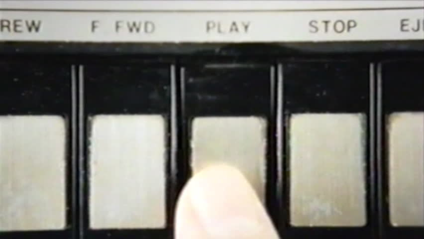 VHS tape capture: pressing play and stop, multiple times, on a vintage player; inserting an audio cassette. Close-up shot. | Shutterstock HD Video #1009644404