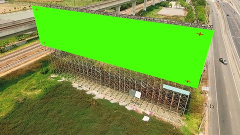 Aerial view of roadside billboard mockup with green screen for advertising placement