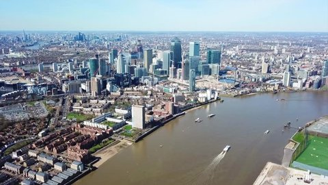 Aerial bird's eye view video taken by drone of famous Docklands and Canary Wharf skyscraper complex, Isle of Dogs, London, United Kingdom