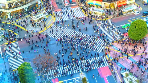 4K. Time lapse pedestrians and traffic across Shibuya Crossing Tokyo, Japan