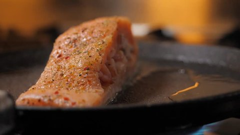 Pan-fried Salmon. Cooking salmon in a pan. Salmon stuffed with shrimps on a pan.