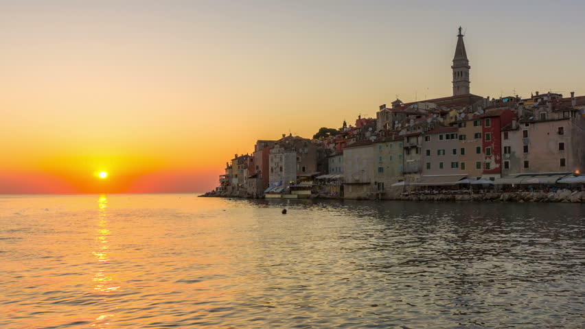 Sunset time lapse at Rovinj, Croatia - Panoramic view of old town of Rovinj in Istria, Croatia at beautiful colorful sunset sky. Rovinj is popular tourist resort, fishing port and culture of Croatia.