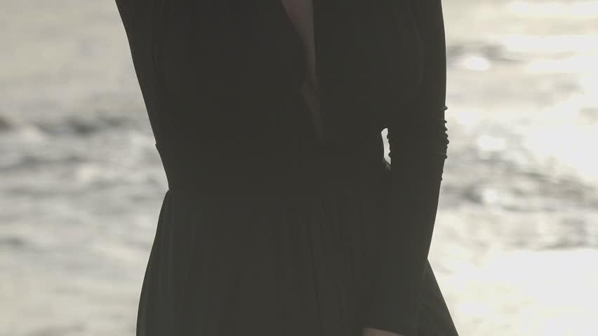 decollete of beautiful women by the sea