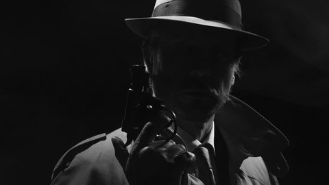 Retro detective spy holding a revolver in the dark and looking around, noir film character