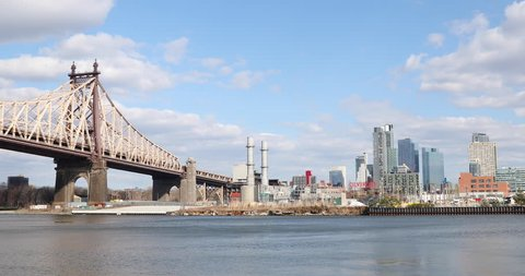 View to the Ed Koch Queensboro Bridge, the East River in Manhattan and the Queens, New York City skyline in the late afternoon.