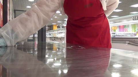 Cleaning cutting table from remnants of food. Application of disinfectant solution. Washing of premises and equipment in food industry, supermarkets, warehouses with food and other similar places.