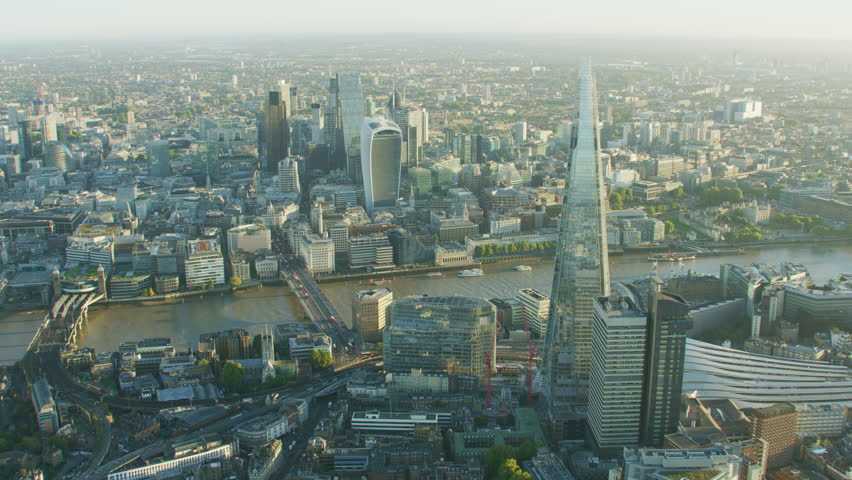 London UK - November 2017: Aerial sunrise view London city skyline financial districts The Shard tower morning commuters on London Bridge England UK RED WEAPON