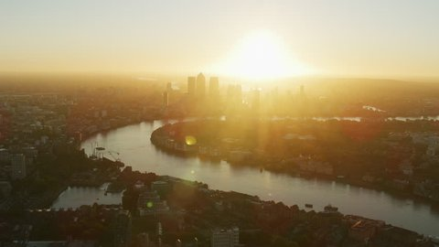 Aerial view London city skyline River Thames and sunrise over skyscrapers of Canary Wharf financial district England UK RED WEAPON