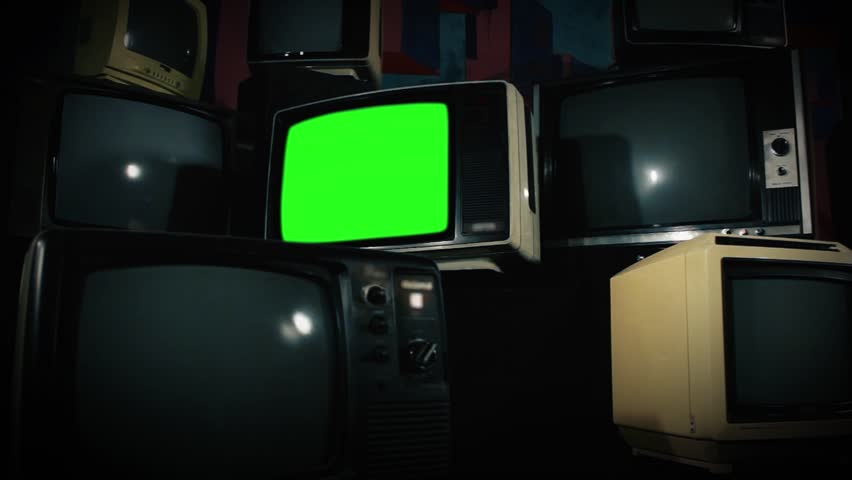 Old Tv Green Screen with Many 1980s Tvs. Zoom Out. Ready to replace green screen with any footage or picture you want. | Shutterstock HD Video #1009774004