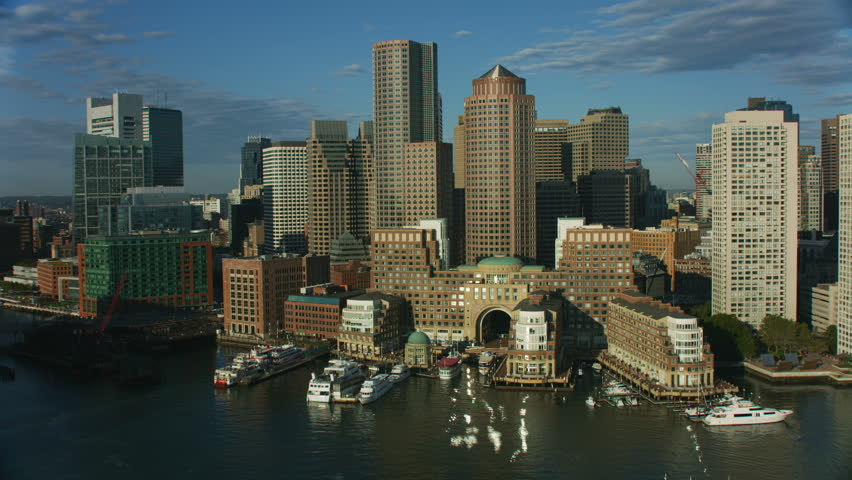 Aerial city view of Rowes Wharf city skyscraper buildings in downtown Boston Financial office business district Main Channel harbor Waterfront Massachusetts America