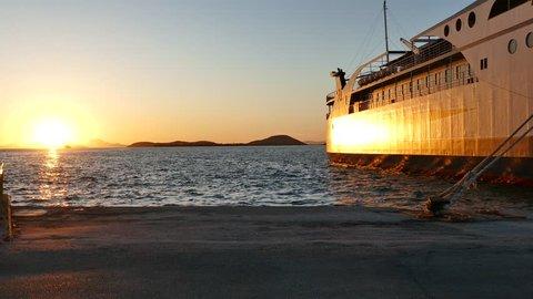Beautiful golden sunset in the port of Igoumenitsa. Ferryboats in Igoumenitsa sea port, Greece.